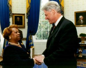 Rev Dr Paige Chargois presents to President Bill Clinton a copy of 'Forgiveness: Breaking the Chain of Hate'