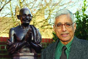 Rajmohan Gandhi by a statue of his grandfather during a visit to Hull