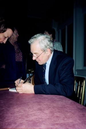Author signing book at Dartmouth House launch