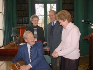 Signing a book for President Hilary King JP after speaking to the ESU in Liverpool in April 2008. Behind are the author's brother and sister-in-law, Gerald and Judith Henderson.