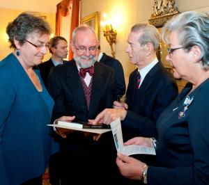 Andrew Stallybrass, director of Caux Books, Eliane Maillefer, Caux archivist and her sister, Danielle Maillefer, present a copy of 'No Enemy to Conquer' to King Michael of Romania at the Elizabetha Palace in Bucharest on the occasion of his 90th birthday (25 October 2012)